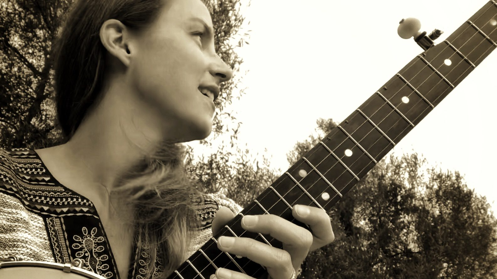 Maggie Pope with guitar